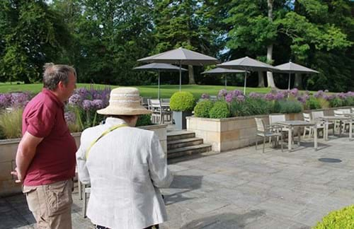Tom Clayton shows Chris Breare the alliums and other blooms on the Clocktower terrace