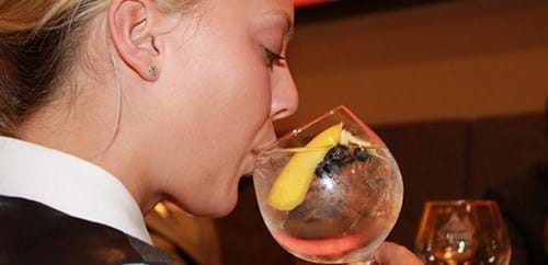 A member of staff tries the signature serving with pink grapefruit, blueberries and an edible flower