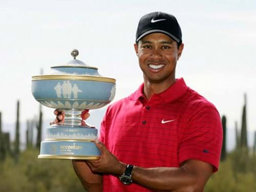 Tiger Woods holding trophy