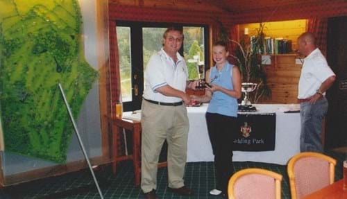 Steph receiving The Junior Girls Championship Trophy from her father, Club Captain Max Davies (2005)