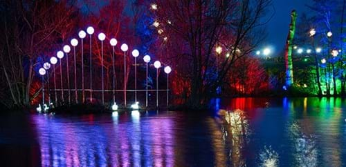 The lake at Stockeld with colourful lights shining on the surface