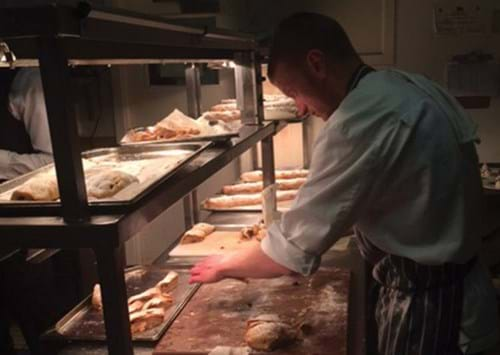 Matthew carving the strudel