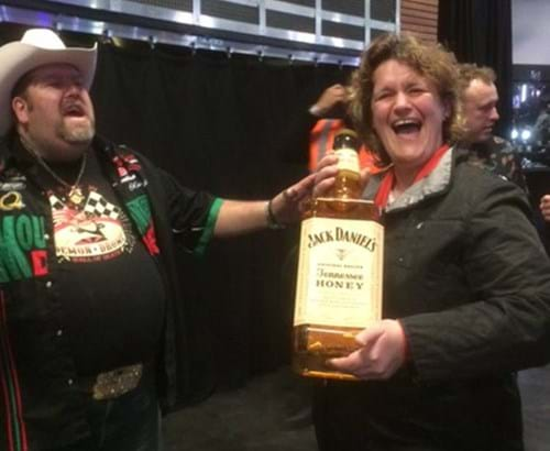 Steph and friend with a huge bottle of Jack Daniels