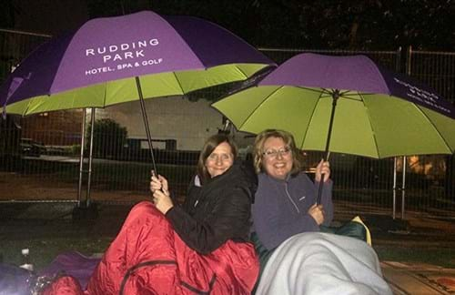Nicola and Carol equipped with Rudding Park umbrellas