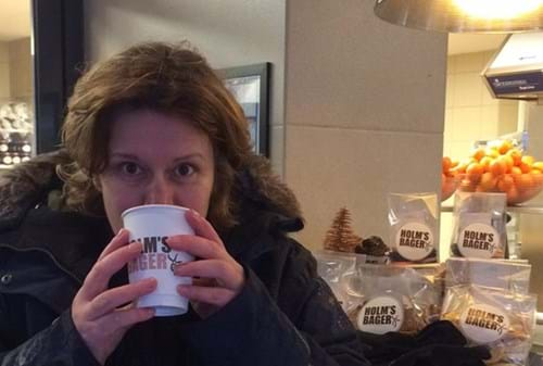 Steph drinking coffee in Holm's Bakery