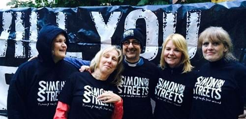 Steph Moon, Elaine Lemm, Lionel Strub, Wendy Preston and Gilly Robinson wearing Simon on the Streets t-shirts and hoodies