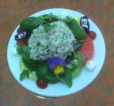 Crab with edible flowers