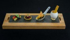 Canapes served on a slate and wood board