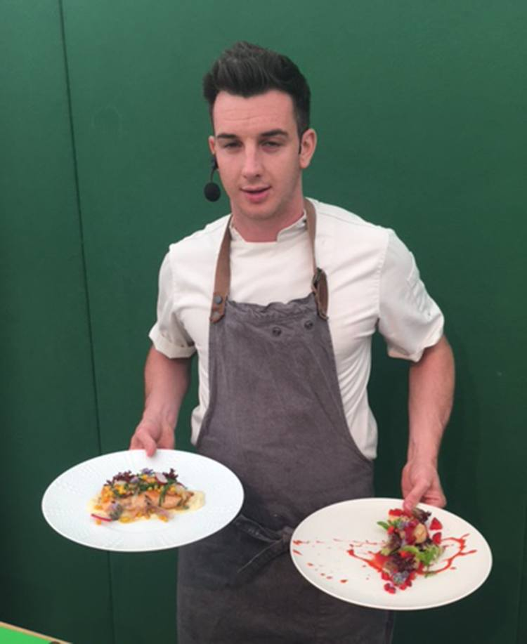 Harrison with his two dishes, including a very bright dessert with splashes of red.