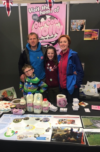 Our Cow Molly family with some of their dairy products and posters