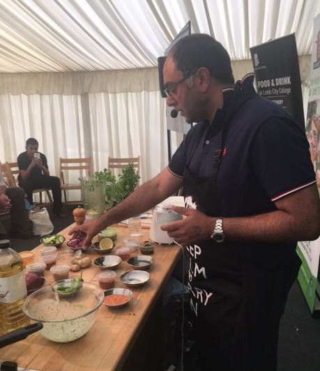 Zulfi with an array of small dishes of spices spread before him