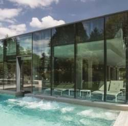 The bold lines of the glass covered section of the Roof Top Spa were planned by the Architect