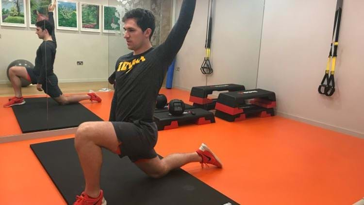Personal trainer showing the hip flexer stretch